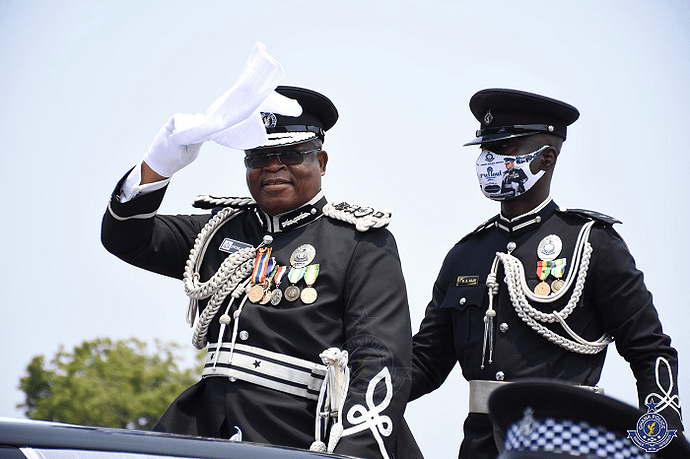 The outgoing Inspector General of Police (IGP), Mr James Oppong-Boanuh (left) with the acting IGP, Dr George Akuffo Dampare