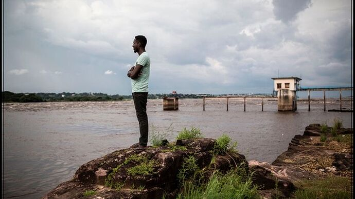 Man staring out at river Congo