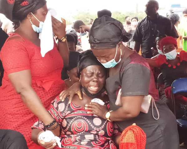 The mother of the slain policeman being consoled