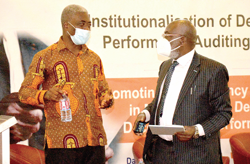 Mr Jacob Essilfie (left) Assistant Auditor-General, Ghana Audit Service, in a conversation with Dr. James Klutse Avedzi, Chairman of Public Accounts Committee. Picture: ALBERTA MORTTY