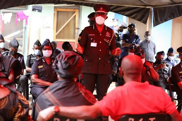 The acting IGP interacting with the families of the victims