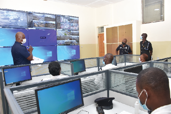 FLASHBACK: Chief Inspector Joseph Zanu (left), General Supervisor of the Motor Traffic Monitoring and Surveillance Centre of the Ghana Police Service, explaining how the monitoring of vehicles is done at the centre
