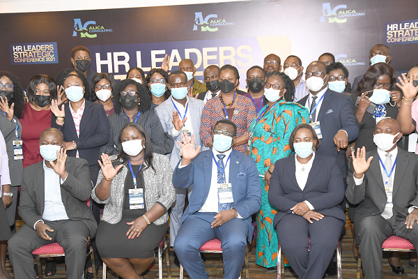 Ms Gloria Quartey (seated 2nd right), Director of Human Resources, Bank of Ghana and Mr Andy Okrah (seated middle), with participants after the opening session of a two-day Hunan Resource Leaders Strategic Conference